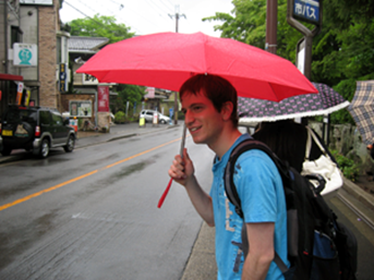 Go Billy Korean under an umbrella
