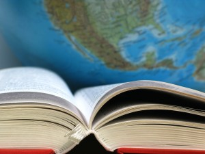 book in front of an earth globe
