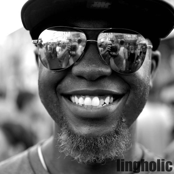 A man wearing sunglasses and smiling