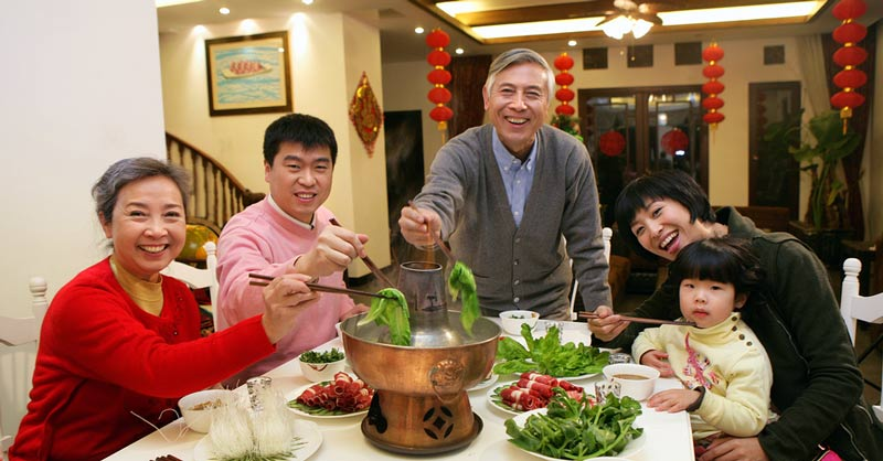 Chinese family enjoying a meal